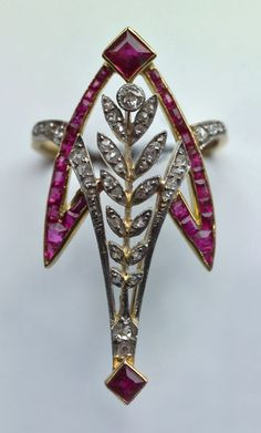 BELLE EPOQUE  Stylised Comet Ring   Gold Ruby Diamond  H: 3.6 cm (1.42 in)  W: 2 cm (0.79 in)   Marks: 'AB' with a sythe & Eagle's head  French, c.1910  Ring Case