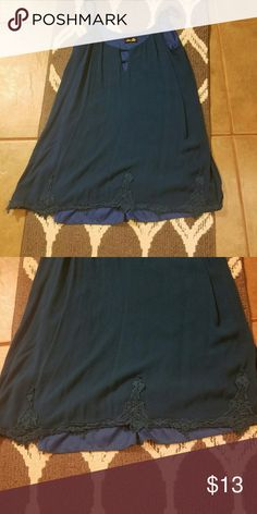 Dee Elle Boutique style top Beautiful dark blue top with scallop bottom. The top is in good condition. I wore it x2. No stains, tear, etc. Top is a size small, but fits a medium. Top is spandex type material. Boutique Tops Blouses