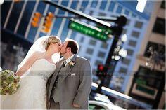 Michigan Wedding Photographers  www.ArisingImages.com  bride and groom kiss on Michigan Ave.