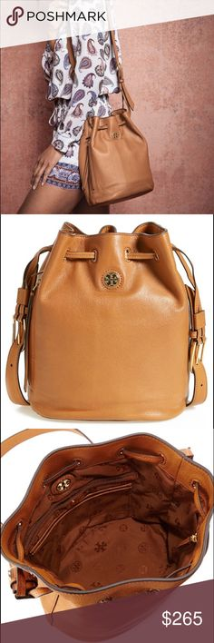 """Tory Burch Brody Bucket Bag This bag is in perfect condition!! I bought it and never ended up using it. It comes with its original tag (unattached) and dust bag. Beautiful, gold logo medallion sets off the supple leather of a lightly structured bucket bag that's destined to make a statement. Features: drawstring closure; adjustable shoulder strap; exterior zip pocket; interior zip, wall and smartphone pockets; logo-jacquard lining; genuine leather. Dimensions: 9""""W x 11 ½""""H x 6""""D. Shoulder…"""