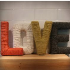 Wrap yarn or twine around wooden letters
