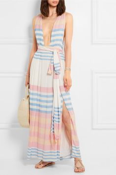 Mara Hoffman's maxi dress is cut from swathes of featherweight crinkled-voile in pastel stripes. It has a plunging neckline and front slits through the skirt for ease of movement - perfect for strolls along the beach on vacation. Use the wrap belt to accentuate your waist.