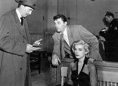 "Robert Mitchum and Lizabeth Scott in ""The Racket"" (1951)"