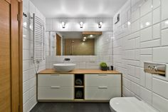 Finally, a white tile bath is the perfect simple cherry on this lovely Scandinavian sundae of a loft.