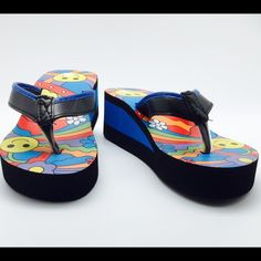 New with tags wedge style flip flops! Smilie Face wedge Flip Flops New With tags. Heel is 1 and 3/4 inch. Runs true to size if you are a half size go up to next size. Available in size 6,7,8,9,10,11 Hbcali Shoes Wedges