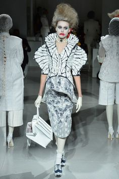 Thom Browne Spring 2014 Ready-to-Wear Collection Slideshow on Style.com  Aside from the crazy face... I love this jacket