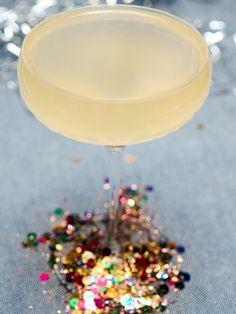 Pinned more for the idea of gluing the confetti on the bottom of the glass... the recipe is just a bonus ;)