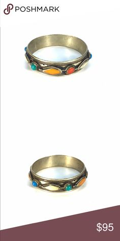 Silver Handmade Multi-Color Bangle Bracelet This ethnic vintage handmade sterling silver bangle bracelet is unique and one of a kind. These gorgeous gemstones are rich in color and the handcrafted details make it a high quality and fashion must have.   Measurements:  Bracelet- 1.5cm thick. 2.5 inches diameter  Condition- Excellent Jewelry Bracelets