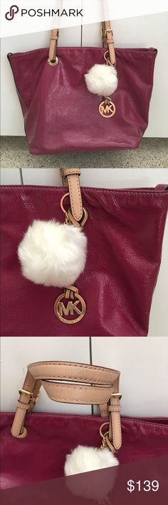 Cranberry MK tote Cranberry colored Michael Kors tote in 100% excellent condition. The handles are in perfect condition, the exterior is in perfect condition, has removable Twillie in white fuzz and gold hardware Michael Kors Bags Totes