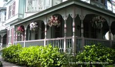 Victorian porches are exquisitely painted. Front-Porch-Ideas-and-More.com #porch #columns