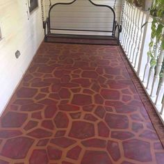 Painted concrete porch with a stone stencil. I don't care for this finish (looks like a huge giraffe) but like the idea with more subtle colors.