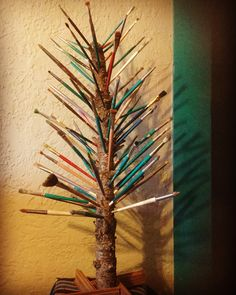 Christmas tree made of artist paint brushes  I made this for my art studio