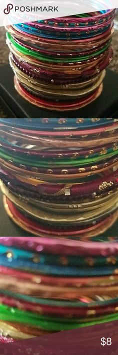 Colorful Bangles Bracelets Set of 32 colored Indian style bangles.  Fun to wear stacked together. Jewelry Bracelets