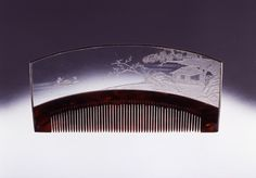 From Suntory Museum of Art - Looks like a glass comb illustrated in a book I have (can't translate the title, though)