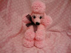 Grandma always had one of these crocheted toilet paper covers- poodles :)