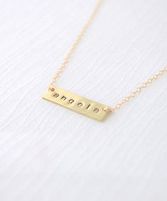 Name Necklace by Olive Yew. Small name bar necklace in gold. The perfect personalized gift for bridesmaids, mom or yourself! $55.00