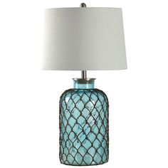Inspired by fishing expeditions and stormy excursions at sea, this charming seeded-glass lamp is wrapped in rustic fishnet and features a crisp linen drum shade evoking a ship's sail. To create a master bedroom fit for a captain, place this design atop shaker-style nightstands on each side of a wooden panel bed, then dress the bed in a white down comforter, adding bold striped shams, a navy blue throw blanket, and accent pillows embroidered with anchors. Carry the nautical design to...