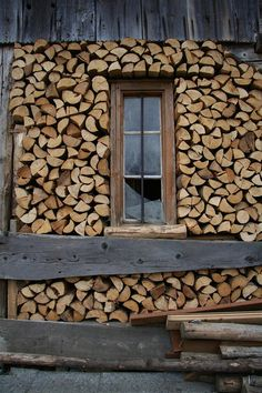 Cord Wood - stacked around a window.  Creating an overhang to keep firewood relatively dry is a good idea, but I feel like it would be necessary to create this feature when the house or outbuildings was built. | from bloglovin.com