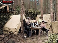 officers of the 114th Pennsylvania Infantry, as they relax in the woods of Petersburg, Virginia, engaged in a game of cards.  1864