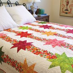 Lucia Stars is an easy fast queen size quilt pattern featuring a striking floral print. Simple piecing makes this a truly fast bed quilt to make. Patchwork Quilt, Batik Quilts, Scrappy Quilts, Easy Quilts, Mccall's Quilting, Floral Quilts, Applique Quilts, Strip Quilts, Quilt Blocks