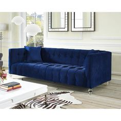 Zuomod, Bea Blue Velvet Sofa - TOV-S85 In $929.Our Bea sofa is a true a beauty. This rich velvet upholstered sofa is designed with a deep seat, luxe tufting and Lucite legs. Bea adds style and color to any room.
