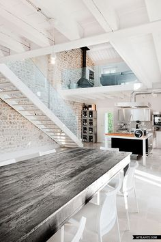 Old building in Italy was completely renovated and turned into a beautiful home. Original architectural details were preserved while the space was filled with modern furniture. Beautiful contemporary staircase and white wooden ceiling completed a wonderful image. Via Afflante.com