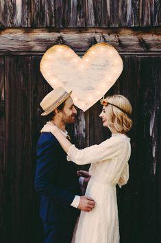 heart-shaped marquee light backdrop, photo by JBM Weddings http://ruffledblog.com/handsome-hollow-wedding-ideas #weddingideas #backdrops