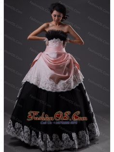 Lace Decorate Bodice Strapless Floor-length Light Pink and Black A-line Quinceanera Dress For 2013- $167.76  http://www.fashionos.com  Be the belle of the prom in this fabulous vintage-inspired gown. It has a lovely strapless bodice with a gathered texture and dreamful skirt. The bodice is adorned with exquiste beadings and appliques that make the dress more dignity. The midsection of the gown is cinched by a gorgeous heavily beadwork. The layered skirt adds the charm.