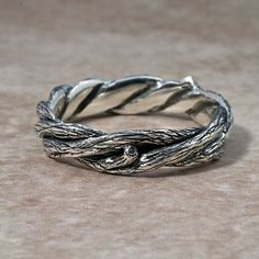 TWISTED TWIGS Wedding Band. This ring made in either 14k yellow gold or white gold.. $545.00, via Etsy.