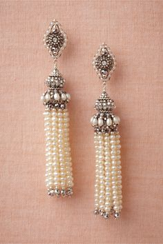 "Tassel Earrings $480.00 Strands of petite pearls softly tinkle beneath intricately beaded medallions and minarets. From Miguel Ases. 3.5""L, 0.5""W. Swarovski crystals, freshwater pearls, pyrite quartz, sterling silver. Handmade in USA."