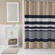 Add contemporary color blocking to your bath with IZOD's Classic Stripe Shower Curtain.  The bold cotton-blend curtain features navy and white contrasting width, sporty stripes over a khaki background.