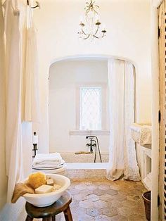 Love the loose linen and and stone texture.  The chandelier is also right down your alley