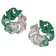Emerald and diamond earrings by deGrisogono