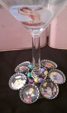 Items similar to Wine charms bottle cap Disney Villains on Etsy Beer Bottle Caps, Bottle Cap Art, Beer Caps, Bottle Top, Bottle Cap Images, Bottle Cap Projects, Bottle Cap Crafts, Creative Crafts, Fun Crafts