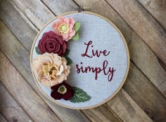 Live Simply Floral Embroidered Hoop Art. 8 Inch Felt Flowers Hand Embroidery. Rose Peach Flower Home Decor. Gallery Wall. Stitched flower. by erinmcmoms on Etsy https://www.etsy.com/listing/275095150/live-simply-floral-embroidered-hoop-art