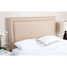Add a touch of sophistication to your bedroom decor with the luxuriously padded upholstery of this headboard. The wheat colored linen upholstery is accented with exquisitely distinctive silver nail head trim.