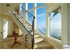 Beautiful wrought iron stair rail - very feminine