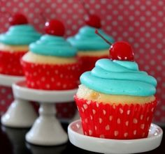 Cupcakes with aqua frosting and cherries on top. #sparklingeverafter