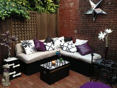 DIY Lounge seating!!! Cinder block and black spray paint as the base. Ole mattress with wire cut out and covered with waterproof fabric as the cushions!!