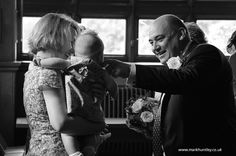 Groom says 'hello' to a young guest. Taken by Mark Huntley Wedding Photography www.markhuntley.co.uk #Eastbourne #EastSussex
