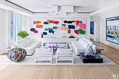 I love the pops of color taken from the painting and added to the rest of the interior.