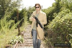 Norman carrying a big gun.