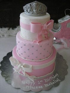 A pink shabby chic girl first birthday party with a gorgeous cake and cupcakes…