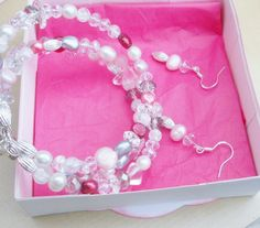 Sterling Silver bracelet with matching earrings. All findings are Sterling Silver - all beads are precious and semi precious stones - no glass here!!! Rose quartz, cultured pearls - various colours, Sterling Silver spacer beads, crackle quartz