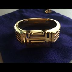 Tory Burch Fitbit Bracelet This is a gently loved Fitbit bracelet, perfect for dressing up your wearable tech! The original box, dust bag, and bracelet are included - PLUS a classic black Fitbit bracelet.                             *Fitbit tracker is not included* Tory Burch Jewelry Bracelets