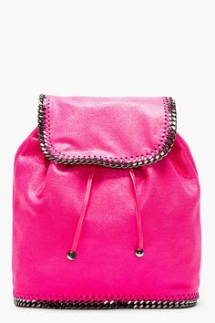 Unstructured glossy faux-leather rucksack in bright pink. Gunmetal-tone hardware. Tonal braided faux-leather trim throughout. Foldover flap at main compartment with magnetized press-stud closure and drawstring closure.
