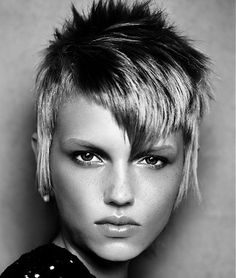 A short blonde straight coloured multi-tonal spikey choppy womens hairstyle by Mark Leeson