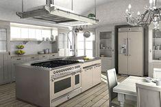 Kücheninsel und Kühlschrank mit Geräten und Funktionsschränken der Steel-Modellreihe Ascot.