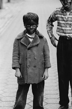 Diane Arbus. This photo raises a lot of questions. What is he hiding from? Is he just having fun? Is he pretending to be a different race?