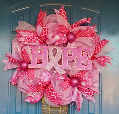 """Breast Cancer Awareness """"Hope"""" Pink Ribbon Deco Mesh Wreath by TwoRoadsDivergedShop on Etsy Breast Cancer Wreath, Breast Cancer Crafts, Deco Mesh Ribbon, Deco Mesh Wreaths, Door Wreaths, Fabric Christmas Ornaments, Christmas Wreaths, Awareness Ribbons, Breast Cancer Awareness"""